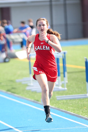 HADLEY GREEN/ Staff photo<br /> Salem's Emily Nikolopous nears the finish line at the Salem v. Lynn track meet at Danvers High School on Tuesday, April 18th, 2017.