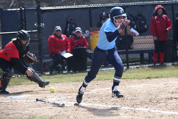 HADLEY GREEN/ Staff photo<br /> Gordon's Katie Dariano (2) sprints to first base after bunting during the Gordon College v. Eastern Nazarene College girls varsity softball game at Gordon College on Saturday, April 8th, 2017.