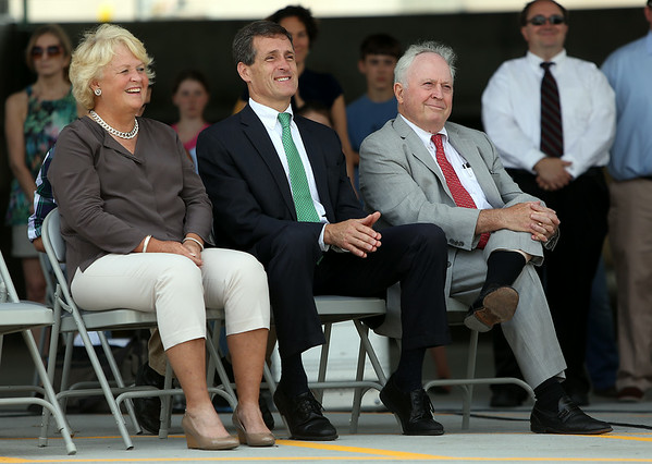 Former State Representative Mary Grant, Beverly Mayor Mike Cahill, and former Beverly Mayor Bill Scanlon, smile as Governor Deval Patrick makes a joke during a ribbon cutting ceremony to open the new Beverly Depot Parking Garage. DAVID LE/Staff photo. 8/1/14.