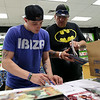 William Choquette, right, a ownership partner of Silver Moon Comics, goes through some last minute inventory with Joshua Berry, left, prior to a soft opening on Wednesday afternoon. Silver Moon Comics is the second comic book store to find a home in Salem and is located in the East India Mall. DAVID LE/Staff photo. 8/20/14