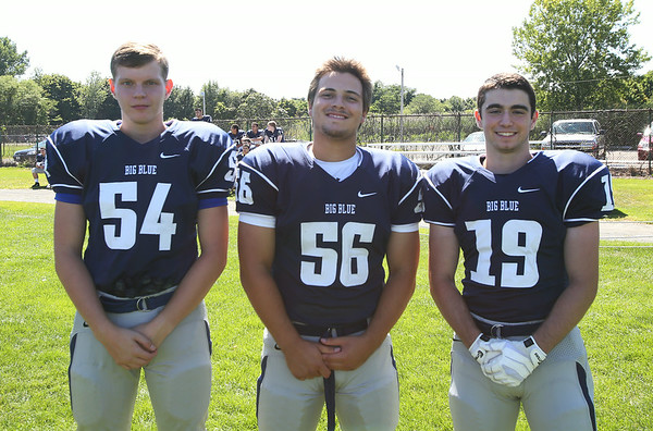 Swampscott High School Seniors Matt Donaher (54), Christian Llorente (56), and Jeremy Epstein (19). DAVID LE/Staff photo. 8/20/14