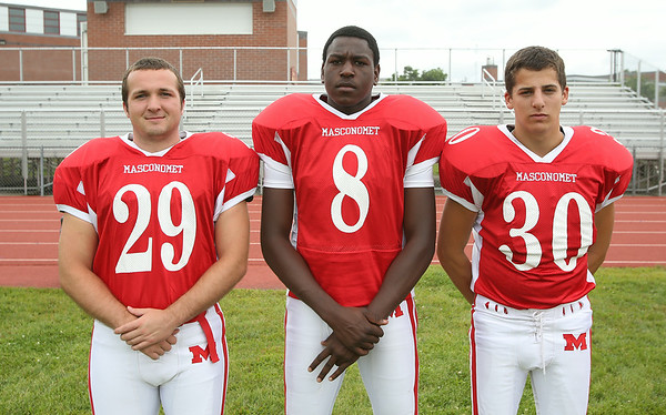 From left: Masconomet Regional High School Seniors Nick Schena (29), Daniel Drigo (8), Adam Green (30). DAVID LE/Staff photo. 8/22/14.