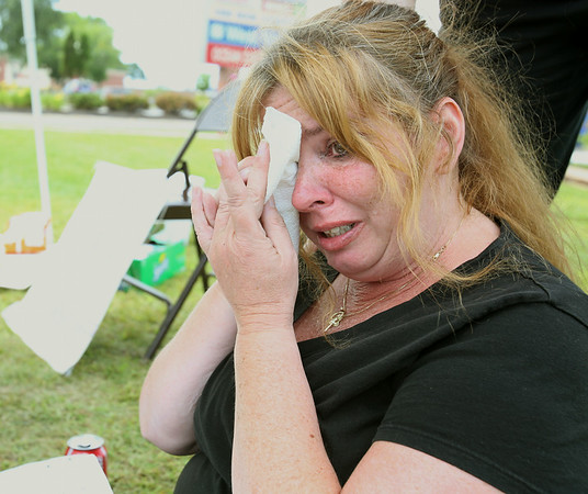 KEN YUSZKUS/Staff photo. Dawn Marie of Lynn is upset after learning the the recent news concerning her job at Market Basket in Danvers.  8/7/14