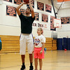 Hamilton native and Philadelphia 76ers guard Michael Carter-Williams goes over free throw techniques with a young camper during the MCW Basketball Camp held at Ipswich High School over a three-day span. DAVID LE/Staff photo. 8/14/14.