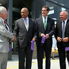 Former Beverly Mayor Bill Scanlon, left, shakes hands with Governor Deval Patrick, as current Beverly Mayor Mike Cahill, and MBTA Project Manager George Doherty, look on. DAVID LE/Staff photo. 8/1/14.