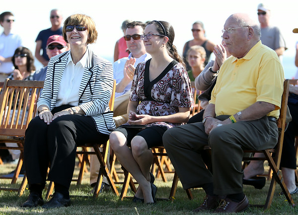 Salem City Councillor at Large Elaine Milo, Ward 2 City Councillor Heather Famico, and Ward 7 Councillor Joseph O'Keefe listen to the speeches on Wednesday morning. DAVID LE/Staff photo. 8/27/14.