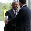 Governor Deval Patrick smiles while shaking hands with Beverly Mayor Mike Cahill at a ribbon cutting ceremony on Friday afternoon to officially open the new Beverly Depot Parking Garage. DAVID LE/Staff photo. 8/1/14.