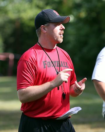 New Salem High School football head coach Matt Bouchard talks to his team prior to the start of practice on Monday afternoon. DAVID LE/Staff photo. 8/18/14.