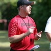 New Salem High School football head coach Matt Bouchard talks to his team prior to the start of practice on Monday afternoon. DAVID LE/Staff photo. 8/18/14.
