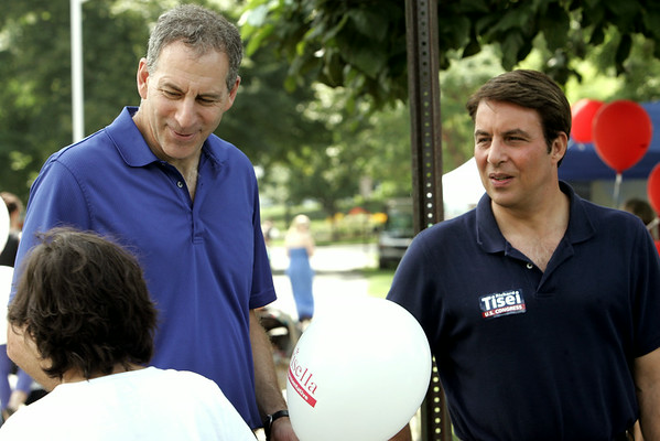 KEN YUSZKUS/Staff photo. Politicians state Rep. Gerry Parisella, left, and Richard Tisei speak with potential supporters during the Beverly Homecoming Lobster Festival at lynch Park.  8/6/14