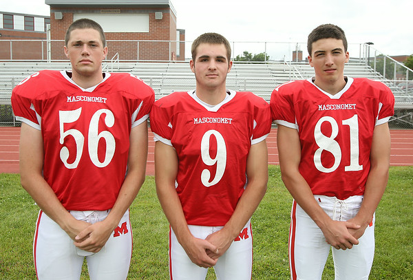 From left: Masconomet Regional High School Seniors Johnathan Schiff (56), Gavin Monagle (9), Derek Cleveland (81). DAVID LE/Staff photo. 8/22/14.