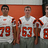 From left: Beverly Football Players Temujin Frost (79), Alex Pavia (63), Tom Adams (88). DAVID LE/Staff photo. 8/22/14.