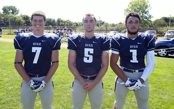 Swampscott High School Seniors Greg Collier (7), Devin Conroy (5), and Anthony Rizzo (1). DAVID LE/Staff photo. 8/20/14