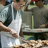 KEN YUSZKUS/Staff photo. Alan Hunter watches over the chicken cooking on the grill at the Senior Day In The Park event held at Lynch Park in Beverly. 8/7/14