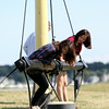 Ann Foo, 19, and her sitter Emma, 16, visiting Salem from Clifton Park, NY, explore a beam on display next to the Friendship in Salem on Monday afternoon. DAVID LE/Staff photo. 8/18/14.