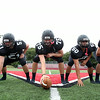 The Marblehead Magicians offensive line: senior right tackle Derek Dumais (79), senior right guard Christian Rudloff (51), senior center Tommy Gabel (75), junior left guard Bryan Graf (50), and senior left tackle Dan Marino (56). DAVID LE/Staff photo. 8/22/14.