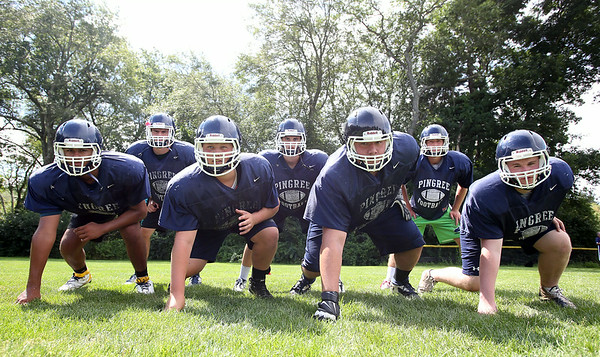 The Pingree Highlanders front seven will look to create problems for opposing offenses. From left, junior Danya Smith, senior captain Kevin Moyette, junior Hunter Jacques, senior captain Connor Bandar, junior Nino Leone, junior Maxx Trotsky, and junior Jack Vantuyl. DAVID LE/Staff photo. 8/21/14.