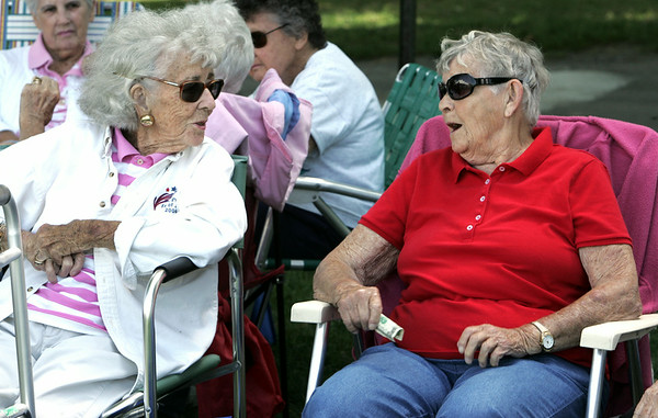 KEN YUSZKUS/Staff photo. Barbara McGann, left, and Virginia Ohearn, both of Beverly, talk while sitting in the shade at the Senior Day In The Park event held at Lynch Park in Beverly. 8/7/14