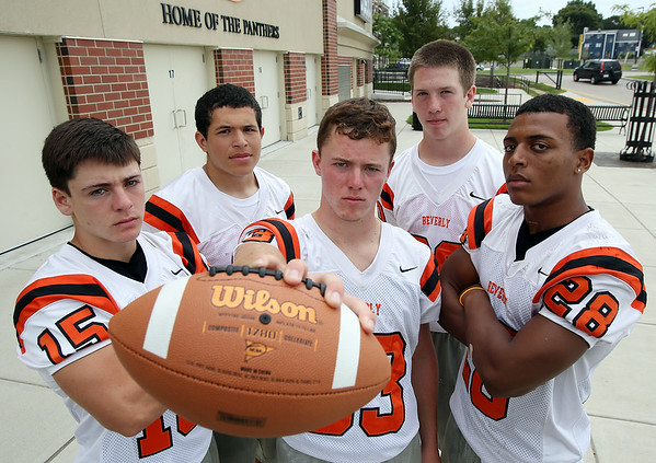 The 2014 Beverly Panthers offense will be led by junior running back Christian Miller (15), senior tight end Anthony Nolasco (85), senior quarterback Bryan Flaherty (33), junior tight end Ryan Garrity (80), and junior running back Matt Madden (28). DAVID LE/Staff photo. 8/22/14.