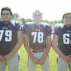 Swampscott High School Seniors Jake Adams (79), Charlie Arena (78) and Barry Tevrow (63). DAVID LE/Staff photo. 8/20/14