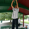 Alan Maldonado, a part of a youth group for at-risk and underserved kids called Journeys of Hope, paints the roof of a gazebo at Charles Curtis Memorial Park in Salem on Thursday afternoon. DAVID LE/Staff photo. 8/21/14.