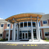 The entrance to the brand new New England Academy building located in the Cherry Hill Industrial Park in Beverly. DAVID LE/Staff photo. 8/20/14