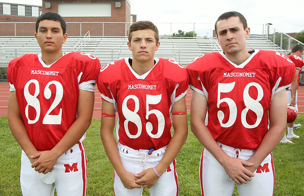 From left: Masconomet Regional High School Seniors Kosta Hantzis (82), Zach Duval (85), Andrew McCourt (58). DAVID LE/Staff photo. 8/22/14.