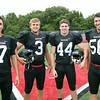 2014 Marblehead Magicians Captains Robert Hill (7), Spencer Craig (3), Brooks Tyrrell (44) and Dan Marino (56). DAVID LE/Staff photo. 8/22/14.
