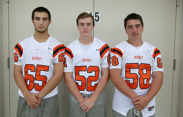 From left: Beverly Football Players Stephen Serino (65), Sean Kalivas (52), Sean Perry (58). DAVID LE/Staff photo. 8/22/14.