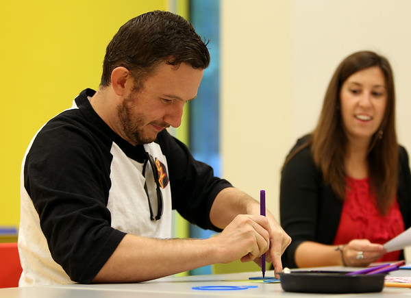 Salem resident Stephen Bass concentrates on making a Spirograph Art piece at the Peabody Essex Museum's Throwback Game Night on Thursday evening. DAVID LE/Staff photo. 8/21/14.