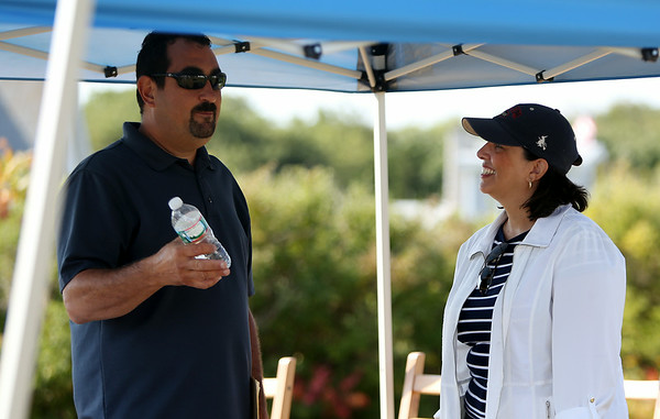 Salem Mayor Kim Driscoll talks with Steve Striebel, President of the Bakers Island Wharf Company, prior to the start of the ceremony on Wednesday morning. DAVID LE/Staff photo. 8/27/14.
