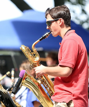 Recent Salem High School graduate Will McCarthy plays a solo on the baritone saxophone while playing with the Salem High School Jazz Band during the Salem Jazz and Soul Festival at the Bandstand at Salem Willows on Saturday morning. DAVID LE/Staff  photo. 8/16/14.