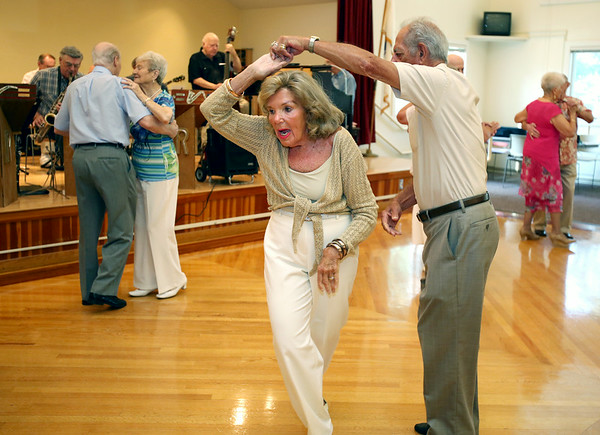 KEN YUSZKUS/Staff photo. Barbara Therrien and Dan Scotina dance to the music of the big band sound of R&R 2000 band at the Beverly Senior Center as part of Beverly Homecoming.  8/5/14