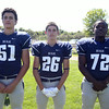 Swampscott High School Seniors Sebastian Camelo (51), Frankie Dilisio (26), and Matthew Young (72). DAVID LE/Staff photo. 8/20/14