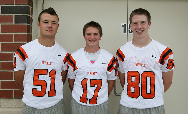 From left: Beverly Football Players Jake Berry (51), Nick Cotraro (17), Ryan Garrity (80). DAVID LE/Staff photo. 8/22/14.