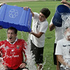KEN YUSZKUS/Staff photo. Beverly Mayor Michael Cahill, left, and State Rep. Jerry Parisella have ice water poured over their heads from, left, Aidan Gallagher, Aidan Cahill, and Jim Parisella. 8/4/14