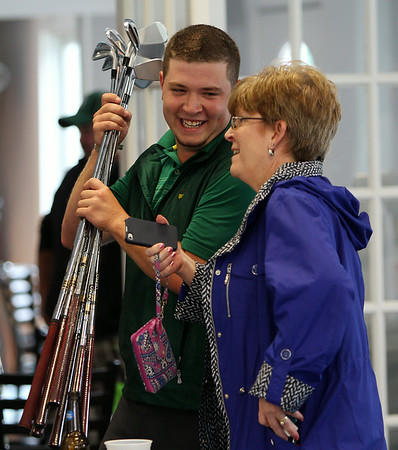 Winner of the 2014 North Shore Amateur Open, Nick Maccario talks with his mother, Kelly, after taking home the title on a rainy Wednesday afternoon. DAVID LE/Staff photo. 8/13/14.