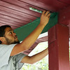 Joshua Mejia, a part of a youth group for at-risk and underserved kids called Journeys of Hope, paints the roof of a gazebo at Charles Curtis Memorial Park in Salem on Thursday afternoon. DAVID LE/Staff photo. 8/21/14.