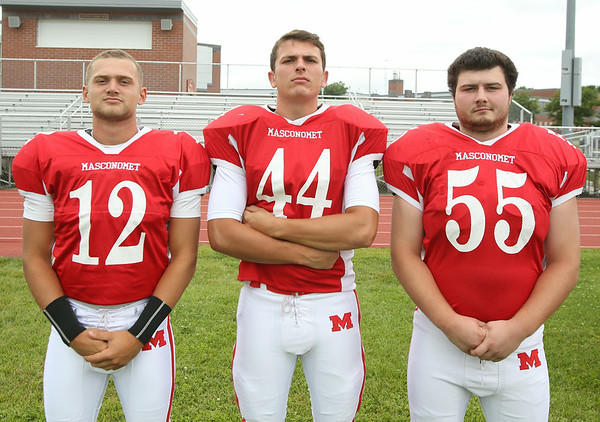 From left: Masconomet Regional High School Seniors Corey Tines (12), Kyle Kowalski (44), Steve O'Reilly (55). DAVID LE/Staff photo. 8/22/14.