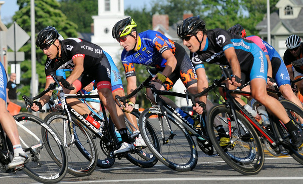PAUL BILODEAUS/Staff photo.   A group of riders in the Master Class make it around the final turn during the Gran Prix of Beverly held last night downtown Beverly. 7/30/14