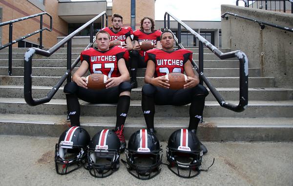 Salem High School football captains for the 2014 season are seniors Joey Byors (57), Glenn Gard (44), Victor Claudio (2), and Genrri Rosario (20). DAVID LE/Staff photo. 8/28/14.