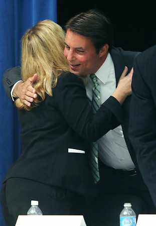KEN YUSZKUS/Staff photo. Candidates Marisa DeFranco hugs Richard Tisei at the conclusion of the Aging and Disability Resource Consortium of the Greater North Shore, Inc. sponsored 6th District candidates forum held at Beverly High School. 8/13/14