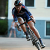 A rider in the Men's Elite Race flies through a tight turn during the Witches Cup around Salem Common on Wednesday evening. DAVID LE/Staff photo. 8/6/14.