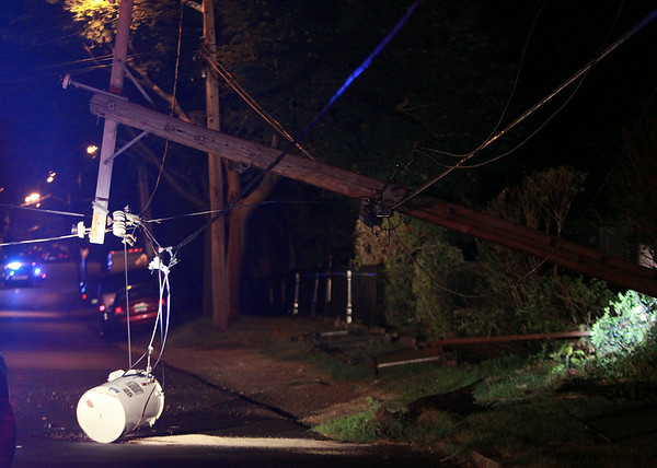 A downed transformer and telephone pole along Appleton Street in Salem. DAVID LE/Staff photo. 8/7/14.