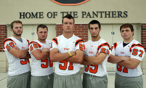 The 2014 Beverly Panthers starting offensive line Senior Strong Tackle Chris Vallette (50), Senior Strong Guard Jimmy Kastrinakis (56), Junior Center Jake Berry (51), Junior Quick Guard Stephen Serino (65), and Junior Quick Tackle Chris Faust (67). DAVID LE/Staff photo. 8/22/14.