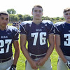 Swampscott High School Seniors Max Petras (27), Ryan Bradley (76), and Tucker Merritt (33) DAVID LE/Staff photo. 8/20/14