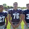 Swampscott High School Seniors Max Petras (27), Ryan Bradley (76), and Tucker Merritt (33) DAVID LE/Staff photo. 8/20/14