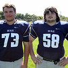 Swampscott High School Seniors Matthew Gooding (73) and Talon Gendron (58). DAVID LE/Staff photo. 8/20/14
