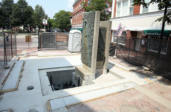 The water fountain at the corner of Essex and Washington Streets at one end of the Pedestrian Mall has been under construction for some time. The repairs were supposed to be completed around the Fourth of July, however, there is still fencing around the area. DAVID LE/Staff photo. 8/1/14.