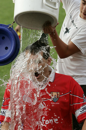 KEN YUSZKUS/Staff photo. Beverly Mayor Michael Cahill has ice water poured over his head a 2nd time by Aidan Cahill. 8/4/14